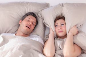 couple in bed with sleep apnea